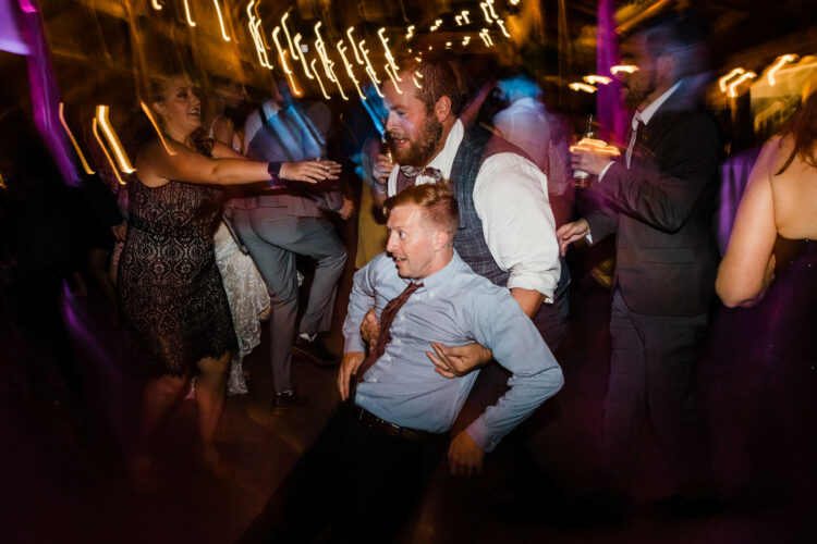 Music masters DJs a wedding at Kiana Lodge in Poulsbo